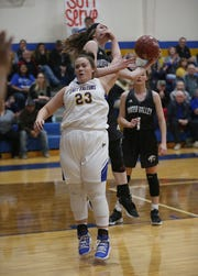 Veribest's Abby Taylor (#23) accidentally catches a Water Valley player in the face as they jump for the ball Tuesday, Jan. 8, 2019 during their game in Veribest.