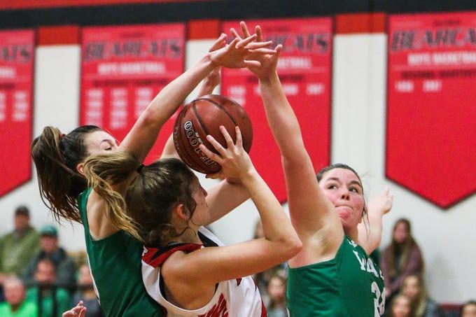 Wall defense blocks a Ballinger player Tuesday, Jan. 8, 2019, in Ballinger High School.