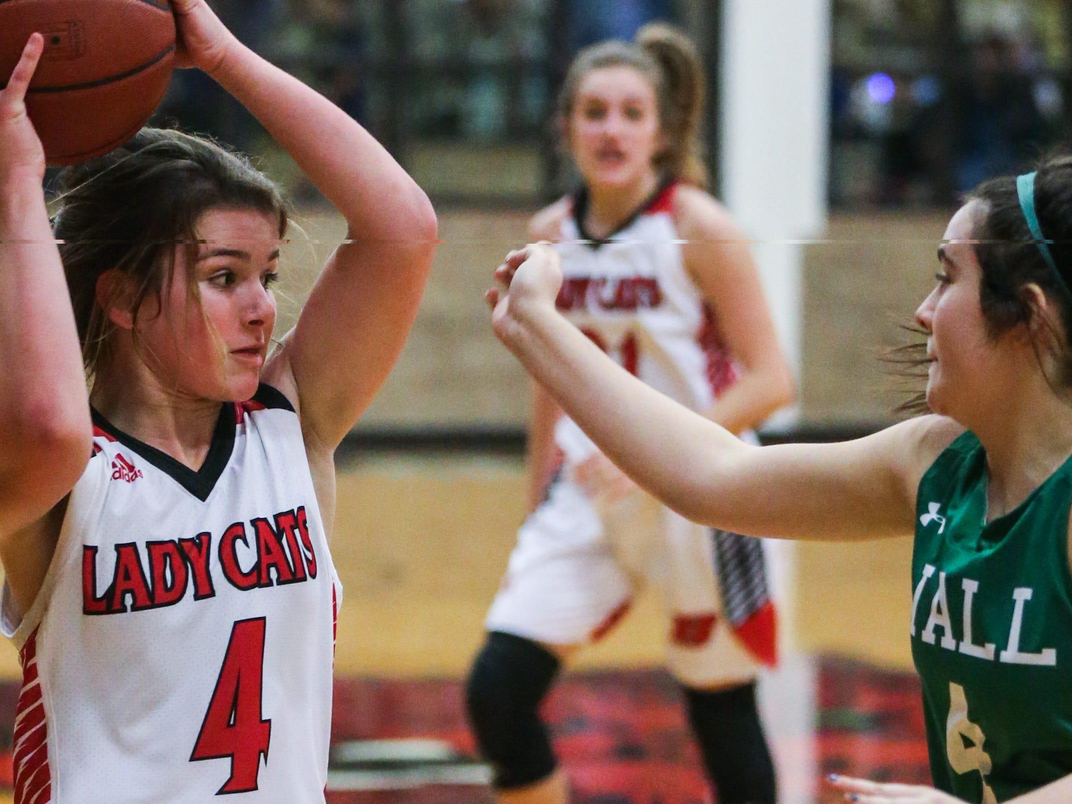 Ballinger's Jenna Battle looks to pass against Wall Tuesday, Jan. 8, 2019, in Ballinger High School.