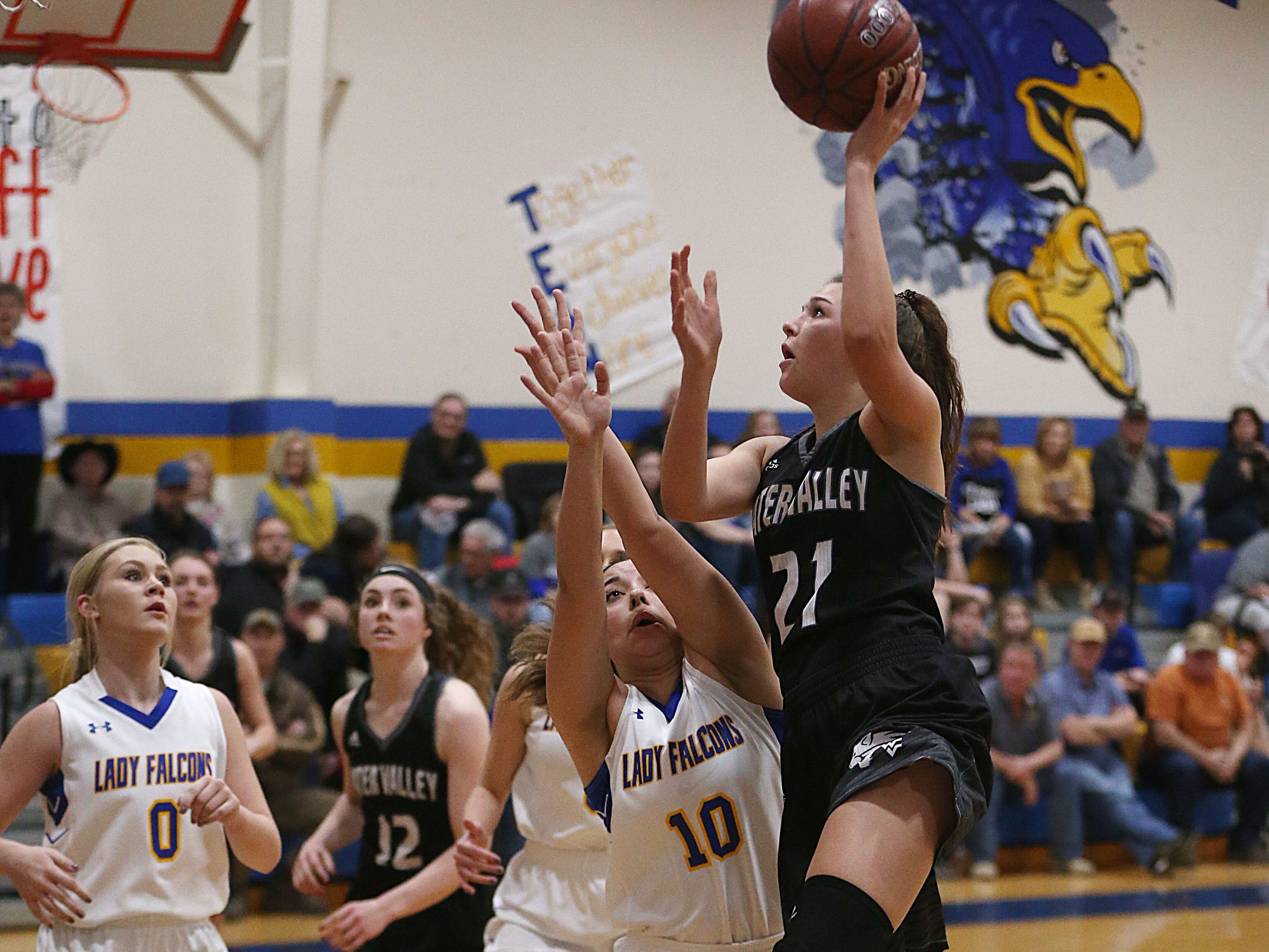 Water Valley's Bailey Dawson (#21) shoots a basket over Veribest's C. Hererra (#10) Tuesday, Jan. 8, 2019 during their game in Veribest.