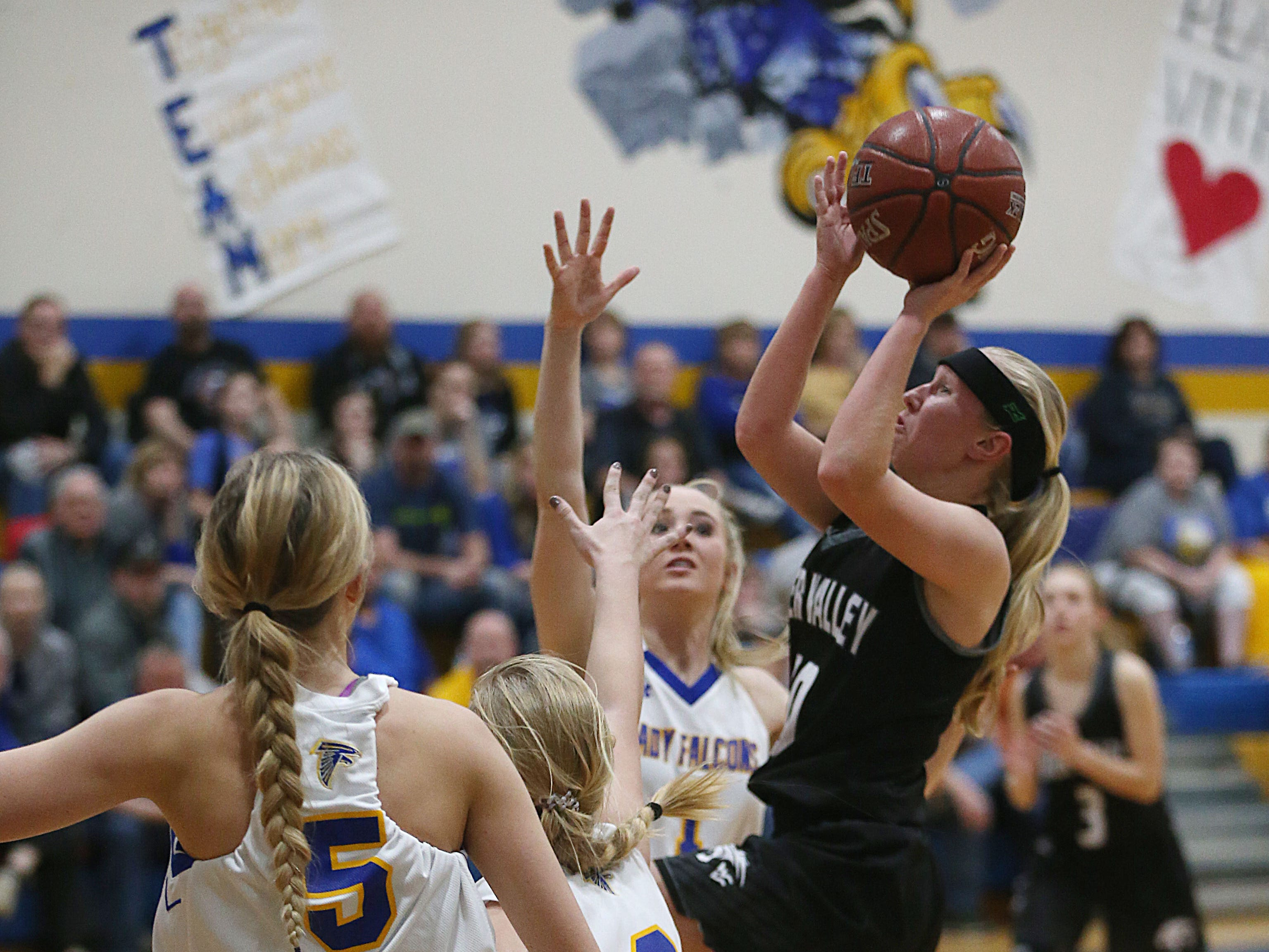 Water Valley's Brittany Sutton (#10) jumps in the air for a shot Tuesday, Jan. 8, 2019 during the game against Veribest.