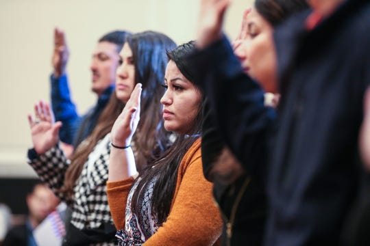 Applicants take an oath during the naturalization ceremony Wednesday, Jan. 8, 2019, at the O.C. Fisher Federal Building.
