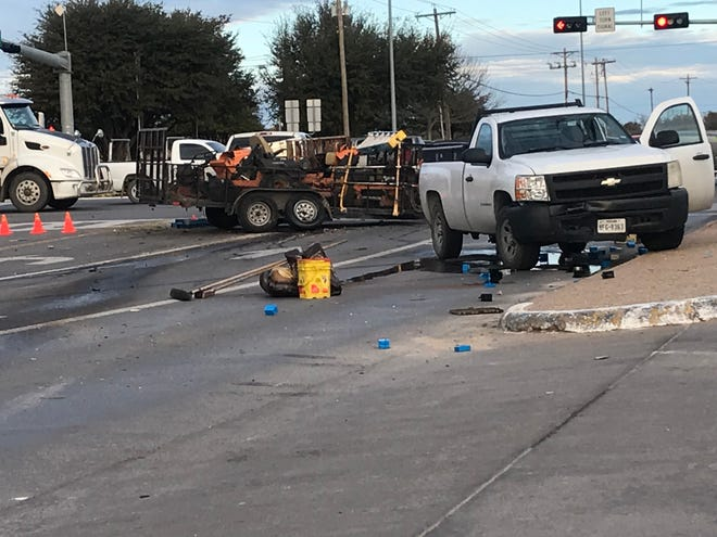 Officers respond to a wreck involving three pickup trucks and a trailer in the 1000 block of Sherwood Way around 8:05 a.m. Wednesday, Jan. 9.