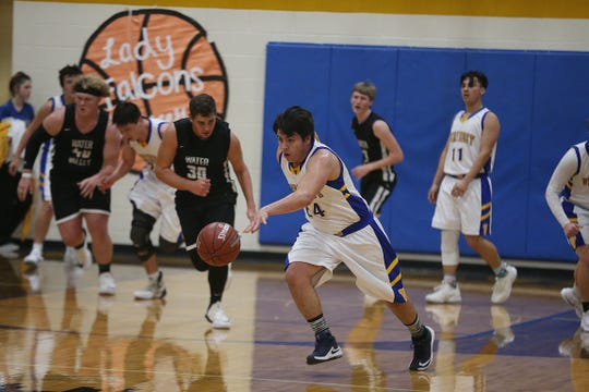Veribest's Zach Bolin (#24) heads to the basket after regaining control of the ball Tuesday, Jan. 8, 2019 against Water Valley in Veribest.