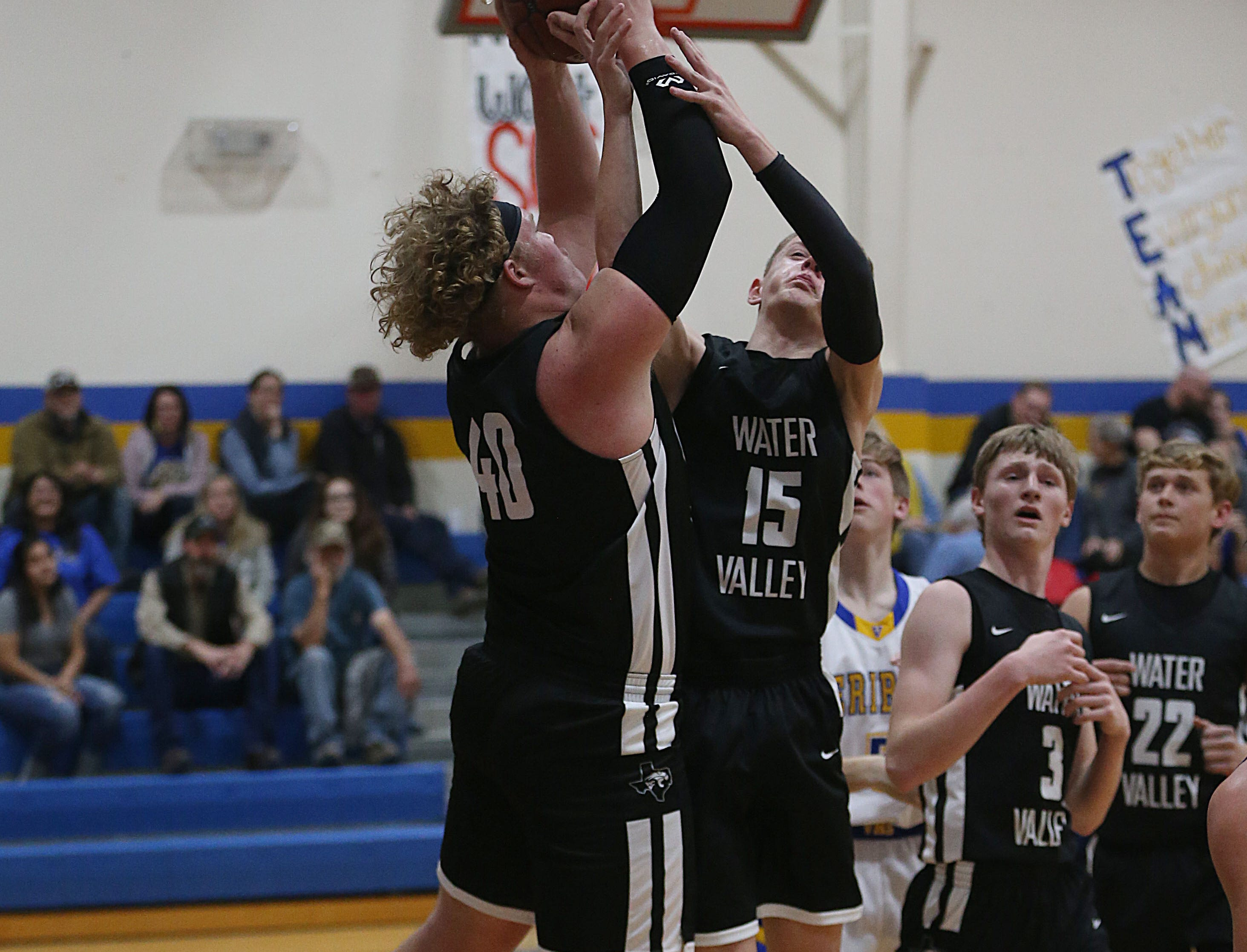 Water Valley players regain control over the ball Tuesday, Jan. 8, 2019 during the game against Veribest.
