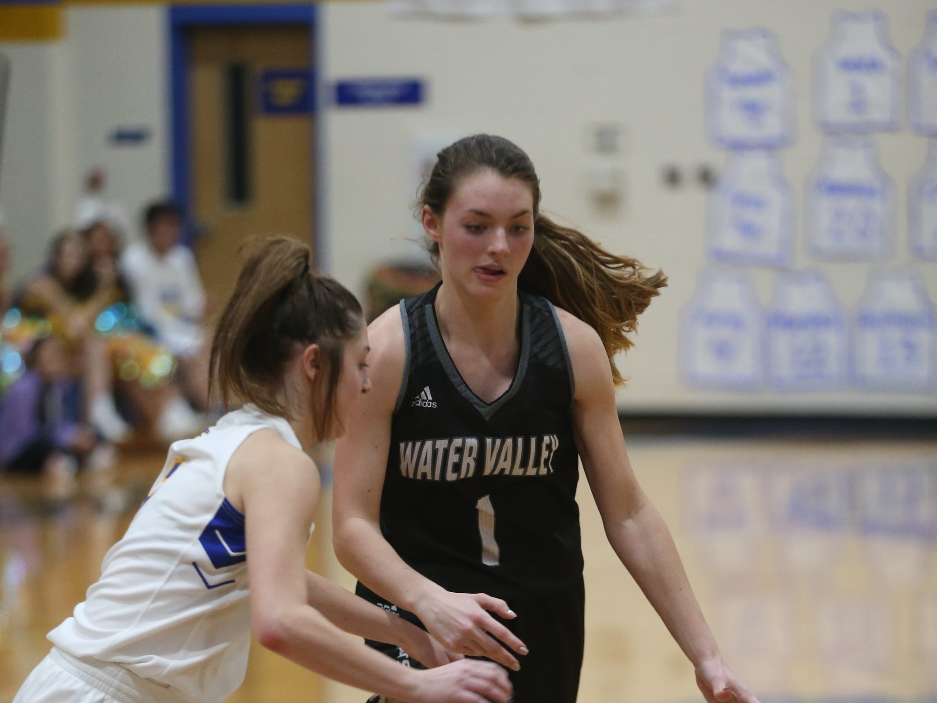 Veribest's Zoe Bratcher (#2) stumbles over a Water Valley player as she heads toward the basket Tuesday, Jan. 8, 2019 during their game in Veribest.