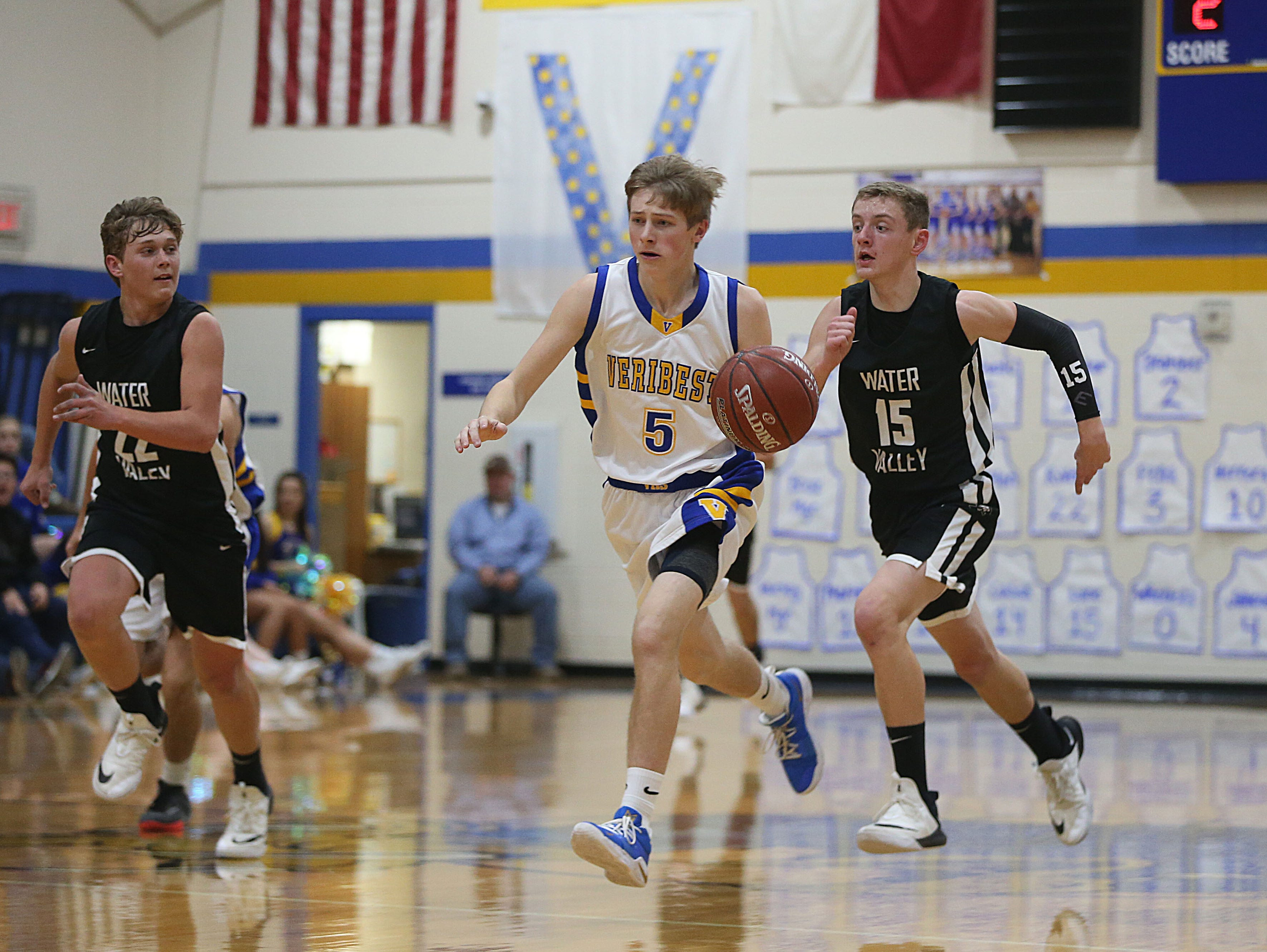 Veribest's Bo Dunn (#5) runs the ball down court followed by Water Valley's C. Hughes (#22) and G. Smith (#15) Tuesday, Jan. 8, 2019 during the game in Veribest.