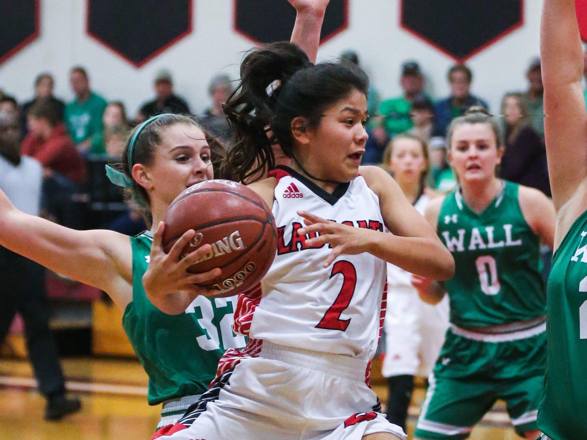 Ballinger's Rosemary Delgado jumps to shoot against Wall Tuesday, Jan. 8, 2019, in Ballinger High School.