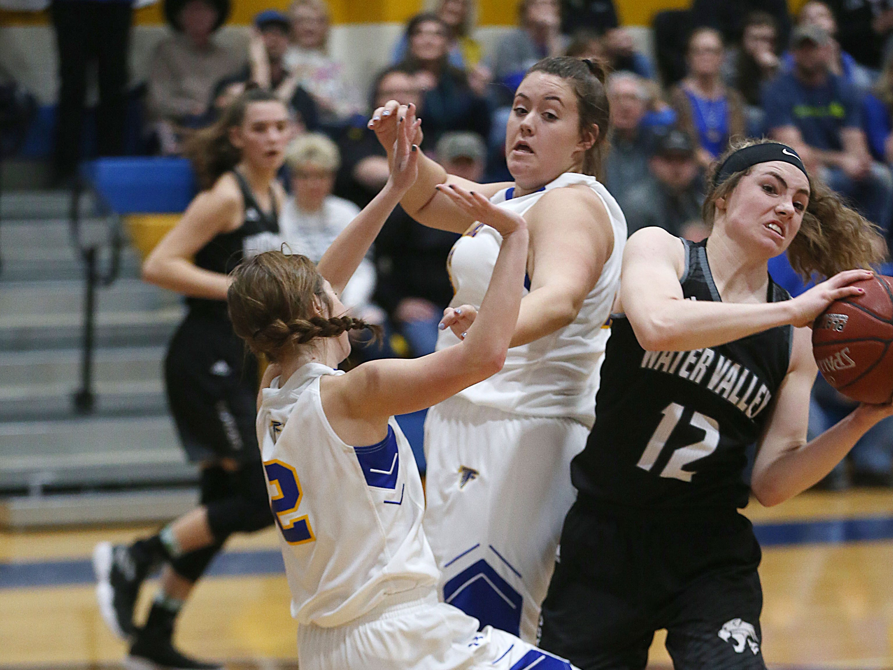 Water Valley's Kalysta Minton-Holland (#12) fights off Veribest players Tuesday, Jan. 8, 2019 to gain control of the ball during their game in Veribest.