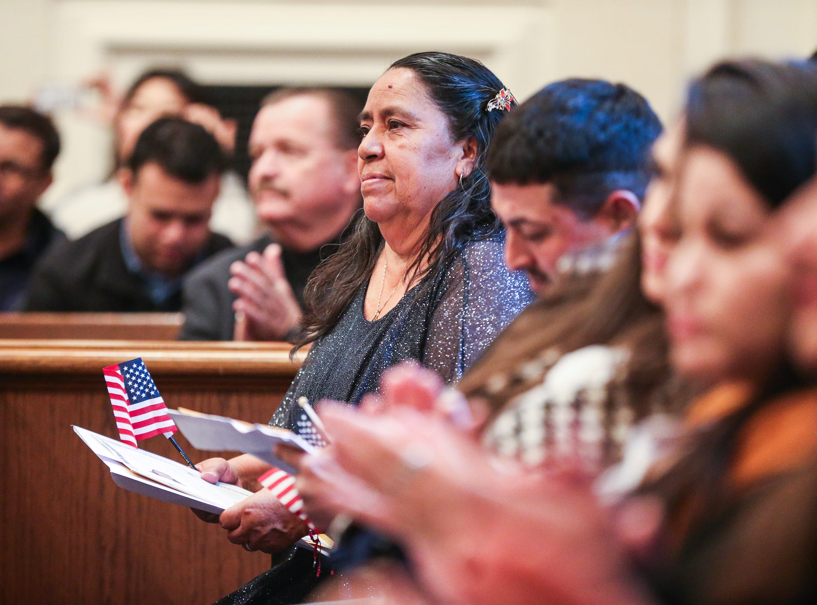 Applicants applaud at the end of the naturalization ceremony Wednesday, Jan. 8, 2019, at the O.C. Fisher Federal Building.