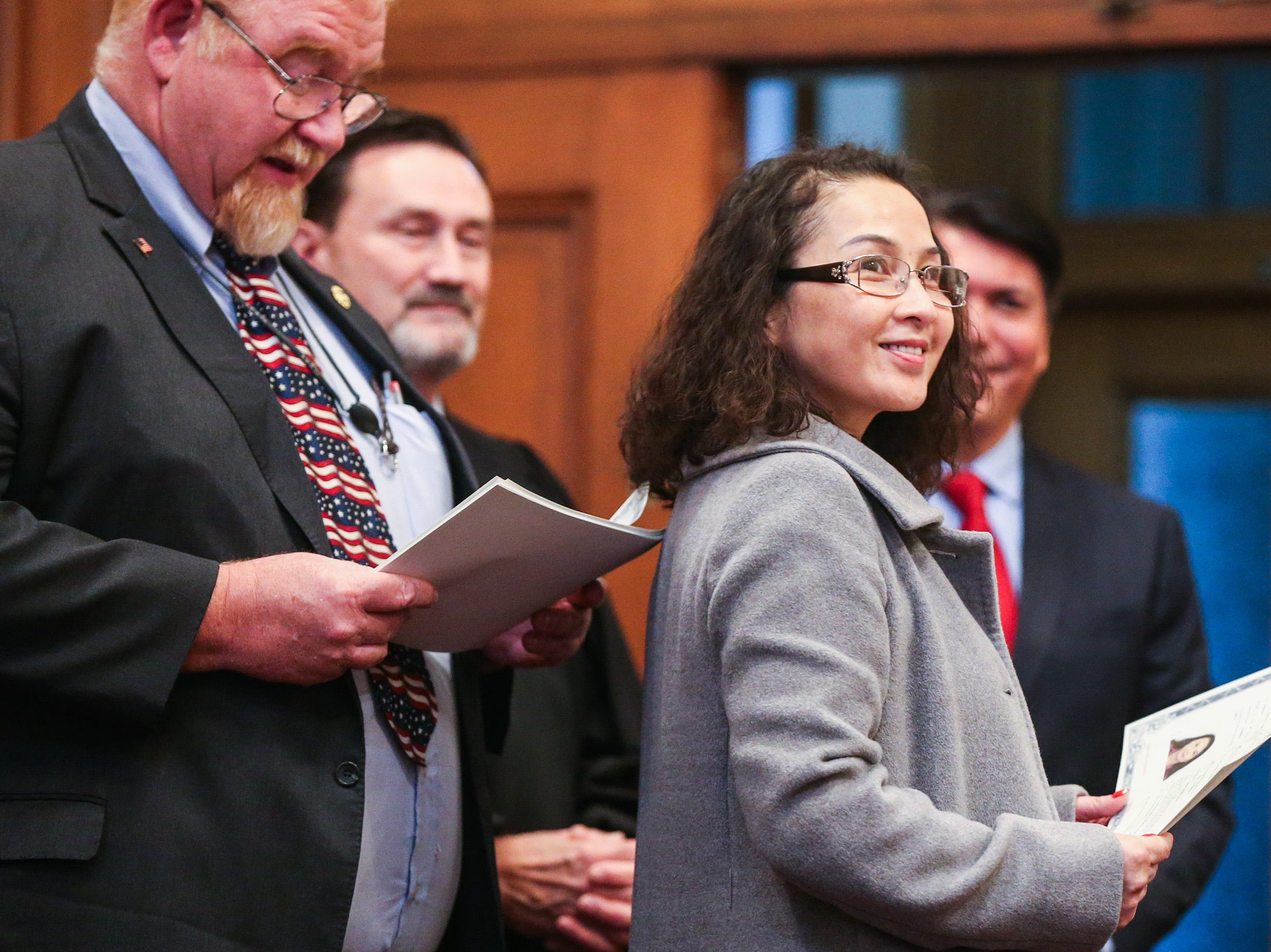 Ying Lv Newton receives her certificate during the naturalization ceremony Wednesday, Jan. 8, 2019, at the O.C. Fisher Federal Building.