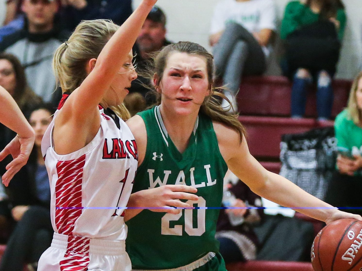 Wall's Landry Reynolds dribbles the ball against Ballinger Tuesday, Jan. 8, 2019, in Ballinger High School.