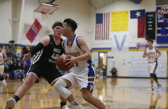 Veribest's Dominic Herrera (#11) is blocked by a Water Valley player Tuesday, Jan. 8, 2019 during the game in Veribest.
