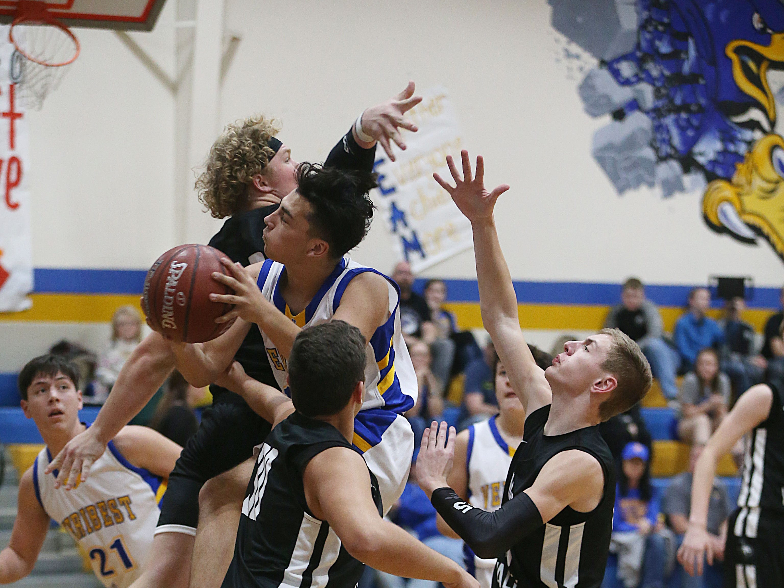 Veribest's Dominic Herrera (#11) pushes past Water Valley players to make a basket Tuesday, Jan. 8, 2019 in Veribest.
