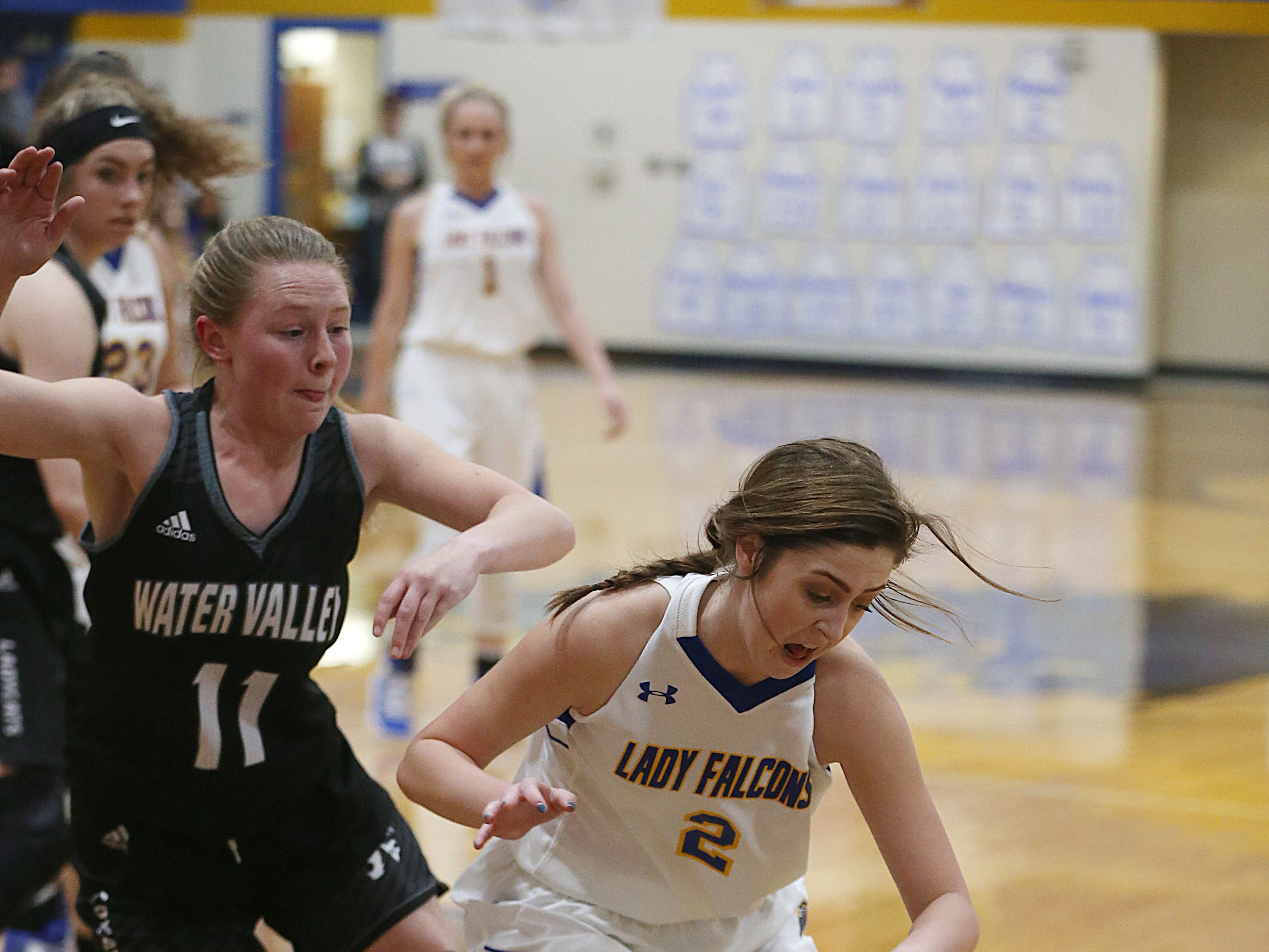 Veribest's Zoe Bratcher (#2) tries to escape from Water Valley's Shelby Kolhs (#11) Tuesday, Jan. 8, 2019 during their game in Veribest.