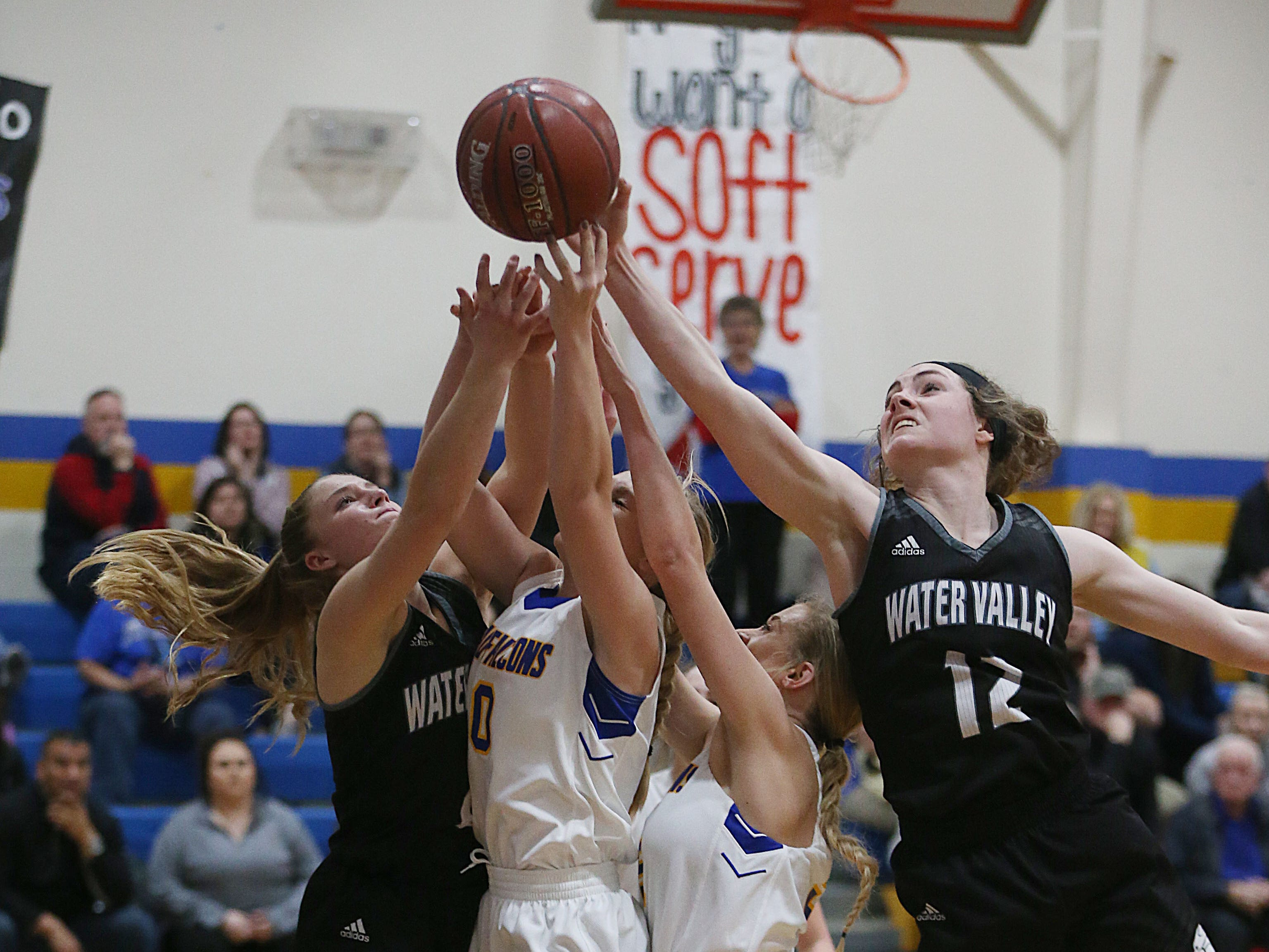 Water Valley's Kalysta Minton-Holland (#12) knocks the ball from the hands of Veribest players Tuesday, Jan. 8, 2019 during the game in Veribest.
