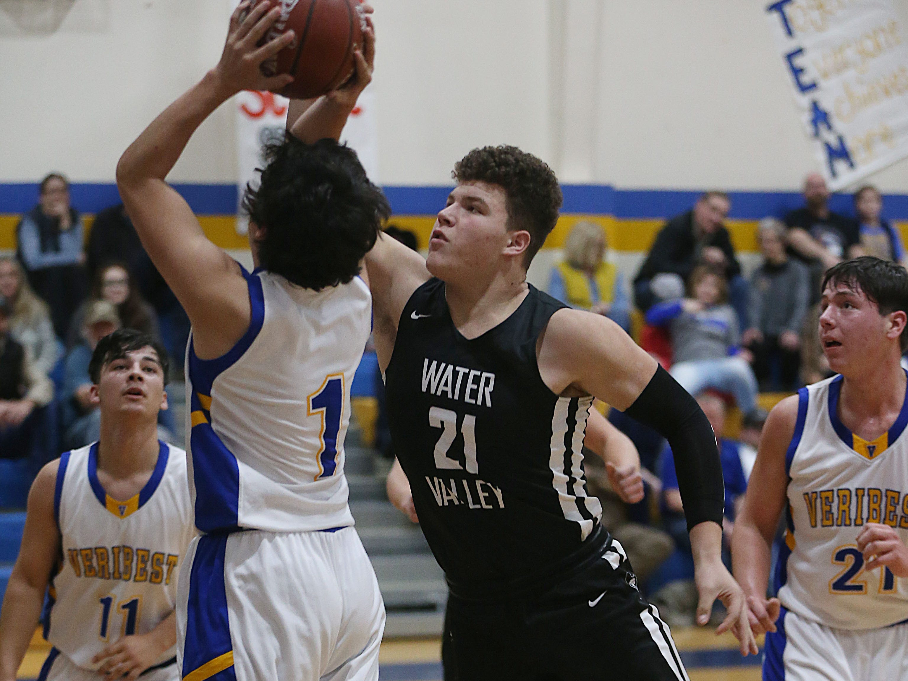 Water Valley's Harley Davis (#21) blocks a shot Tuesday, Jan. 8, 2019 from a Veribest player during the game in Veribest.