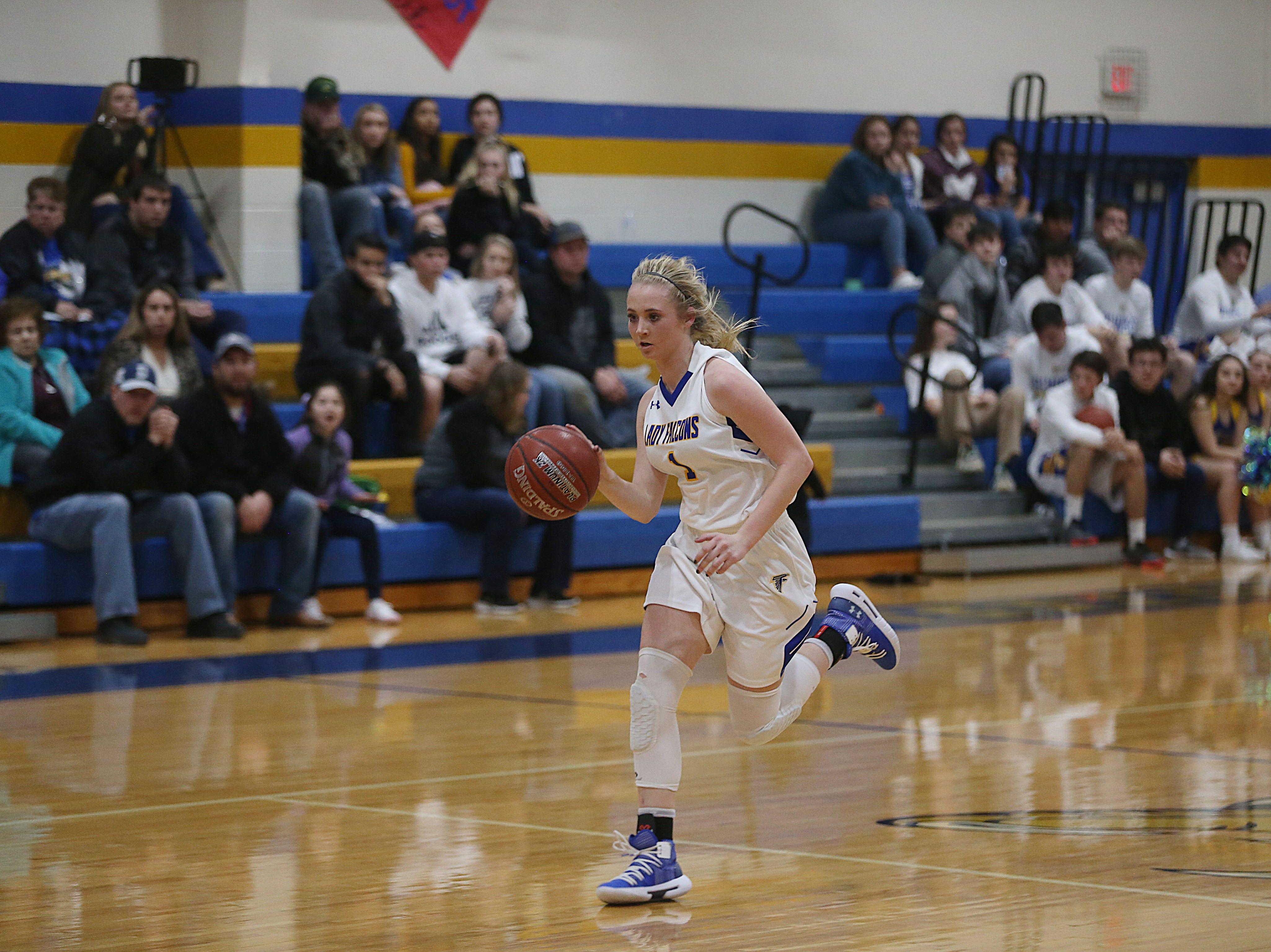 Veribest's Zoe Bratcher Catlyn Ward (#1) rushes to the basket Tuesday, Jan. 8, 2019 during the game against Water Valley in Veribest.