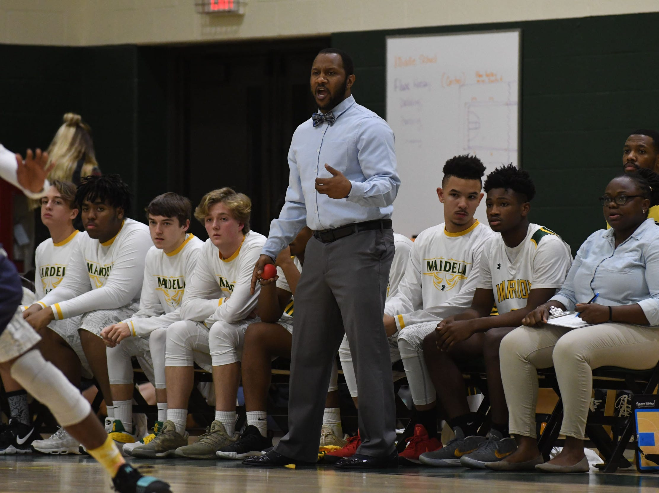 Mardela's Head Coach Jermichael Mitchell on the side lines against Pocomoke on Tuesday, Jan 9, 2019.