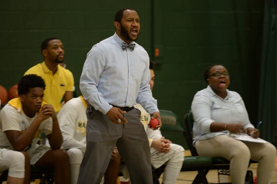 Mardela boys basketball coach Jermichael Mitchell yells to his players on Tuesday, Jan. 8, 2019. Mardela defeated Pocomoke, 76-63.