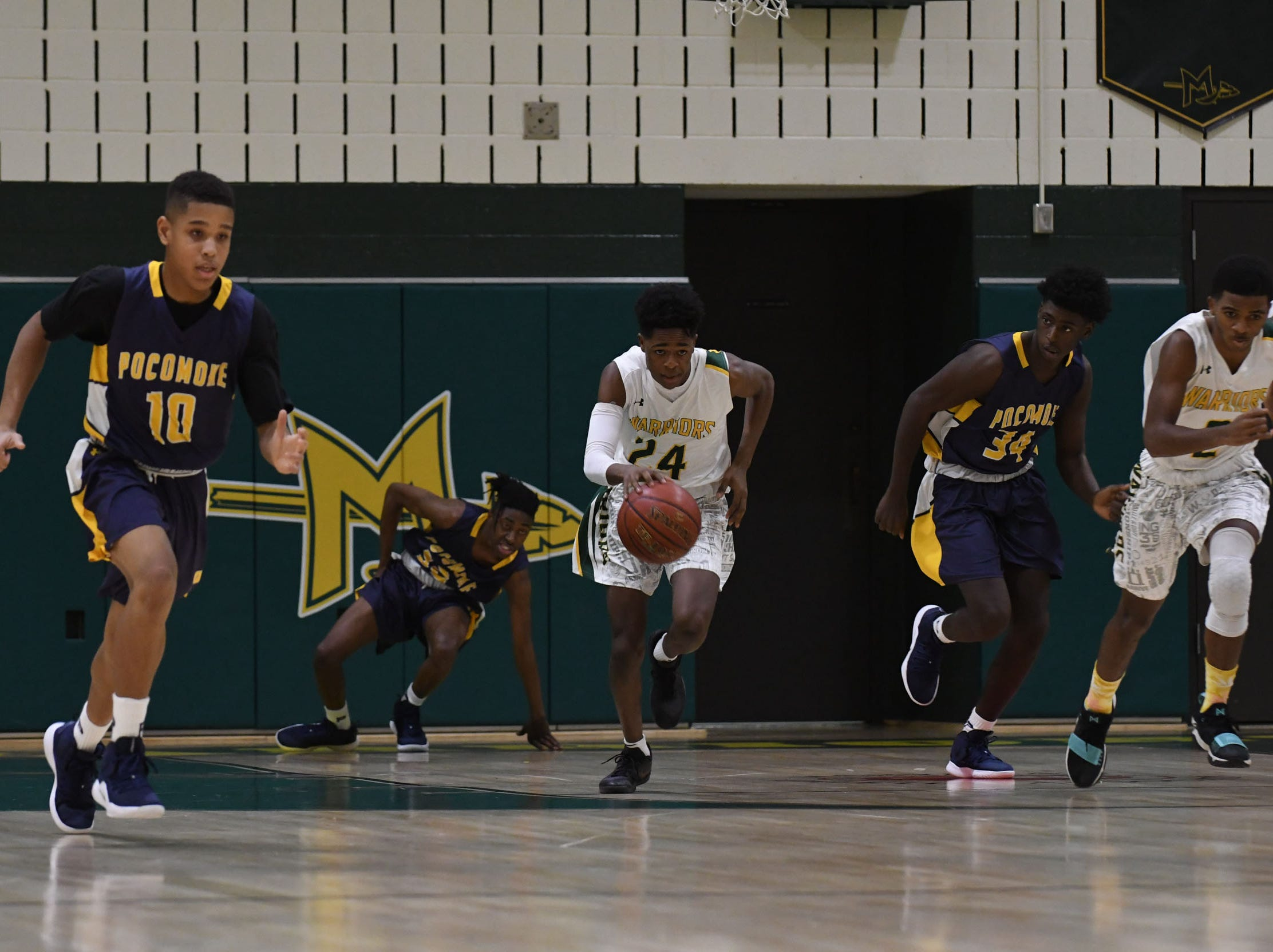 Mardela's Sincere Pinkett brings the ball down the court against Pocomoke on Tuesday, Jan 8, 2019.