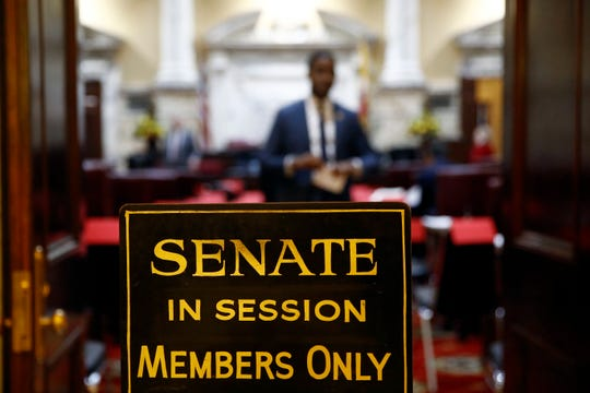 A sign stands outside an entrance to the Maryland State Senate chamber in Annapolis on Wednesday, Jan. 9, the first day of the state's 2019 legislative session.