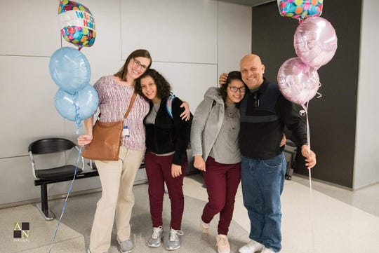 The Fonseca family when the girls arrived in Wisconsin following the completion of their adoption.