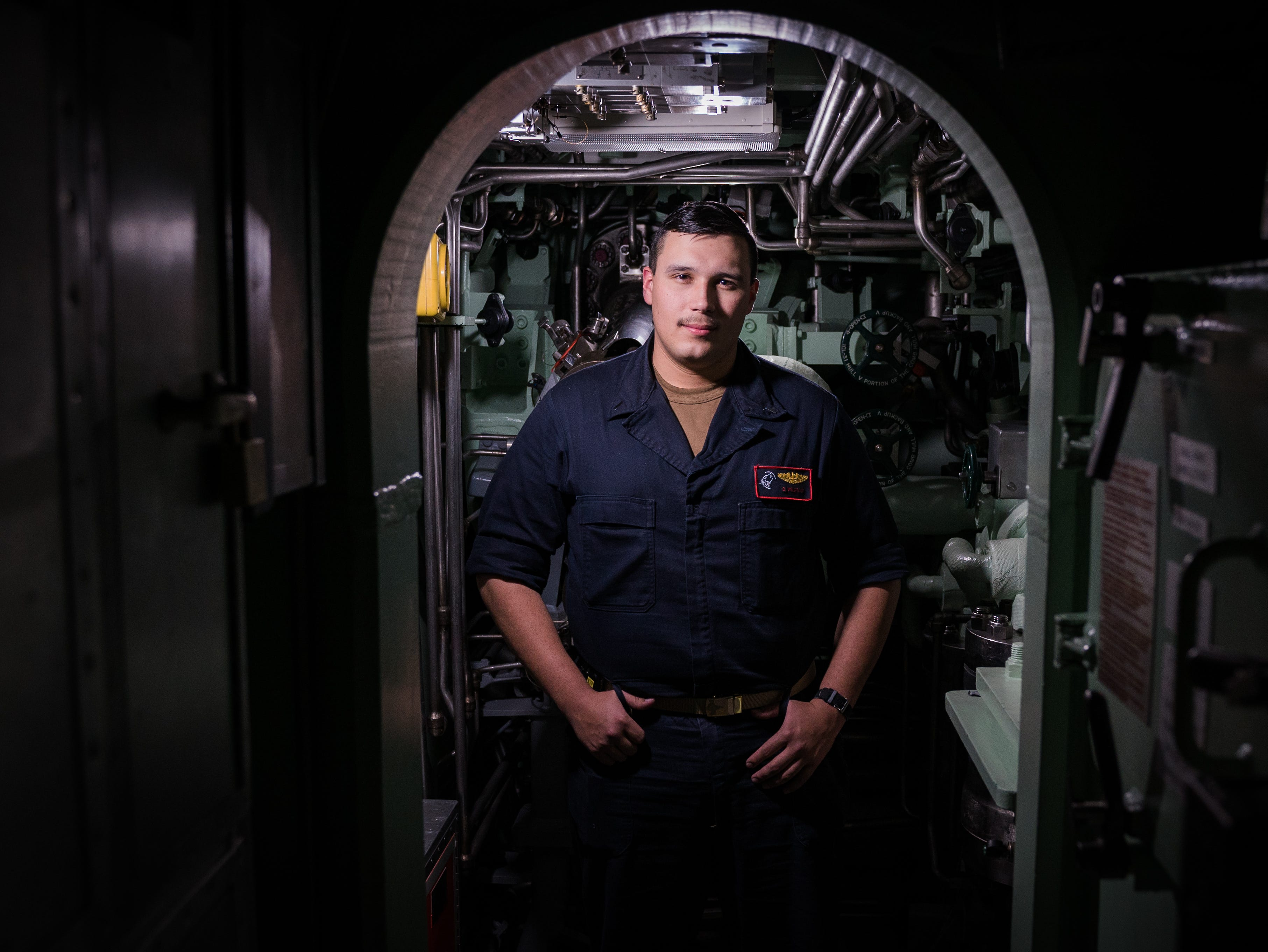 U.S. Navy Lt. j.g. Caleb Weston, a pre-commissioned Unit (PCU) South Dakota submariner, poses for a photo during an underway somewhere in the Atlantic Ocean Nov 27.