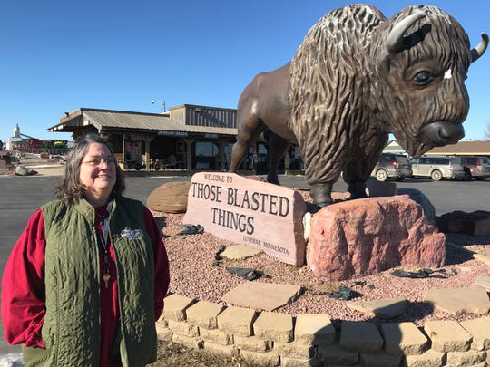 Becky Walgrave, owner of Those Blasted Things, poses for a portrait in front of her gift shop. Walgrave said she was looking forward to increased traffic at her shop from the now-delayed Tru Shrimp project.