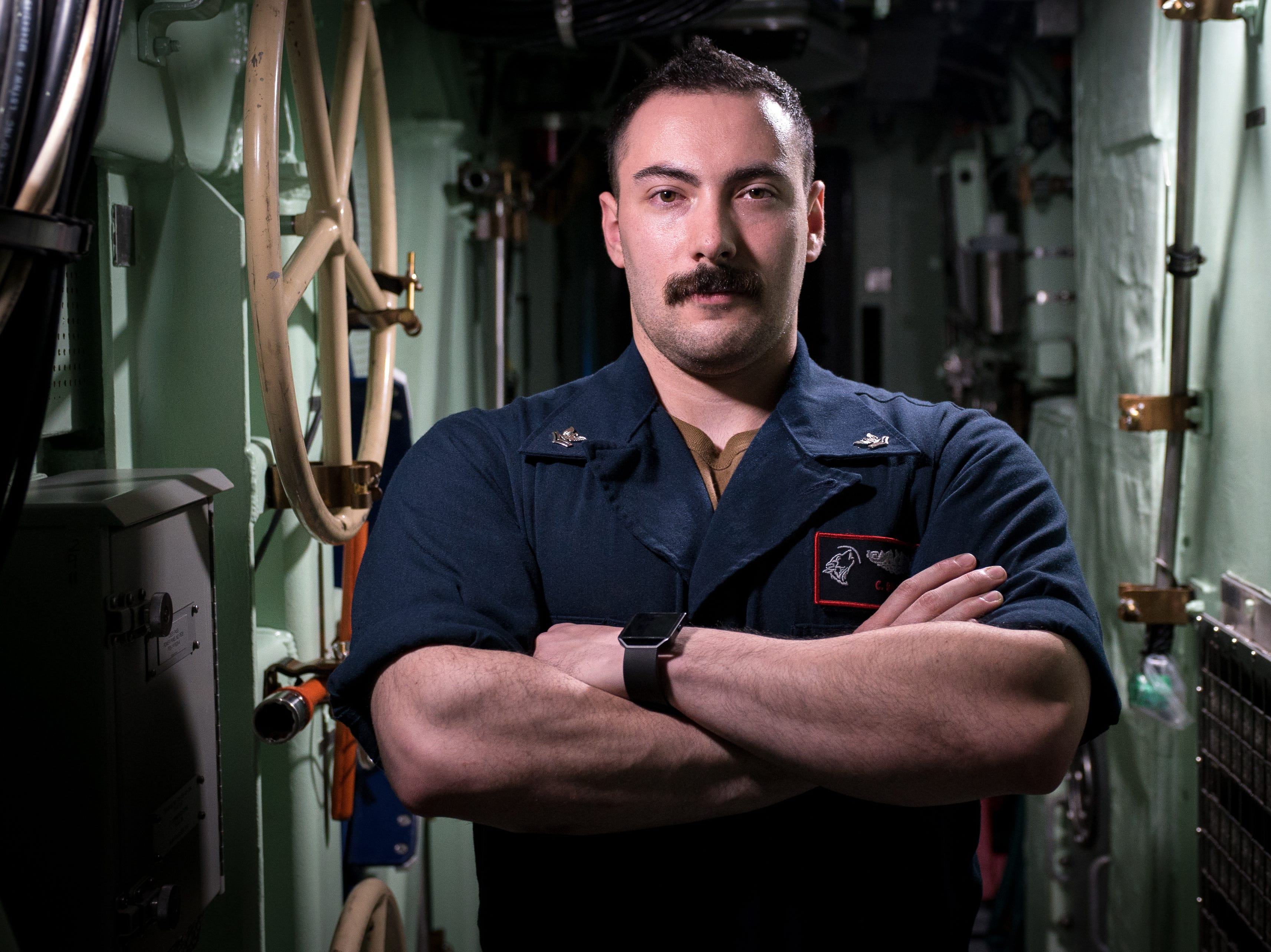 U.S. Navy Petty Officer 2nd Class Christopher Bradley, a pre-commissioned Unit (PCU) South Dakota submariner, poses for a photo during an underway somewhere in the Atlantic Ocean Nov. 27.