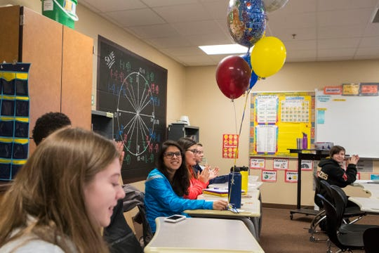 Alayna Garcia receives balloons from Tiger Balloons, a student run business, at Harrisburg High School, Wednesday, Jan. 9, 2019.