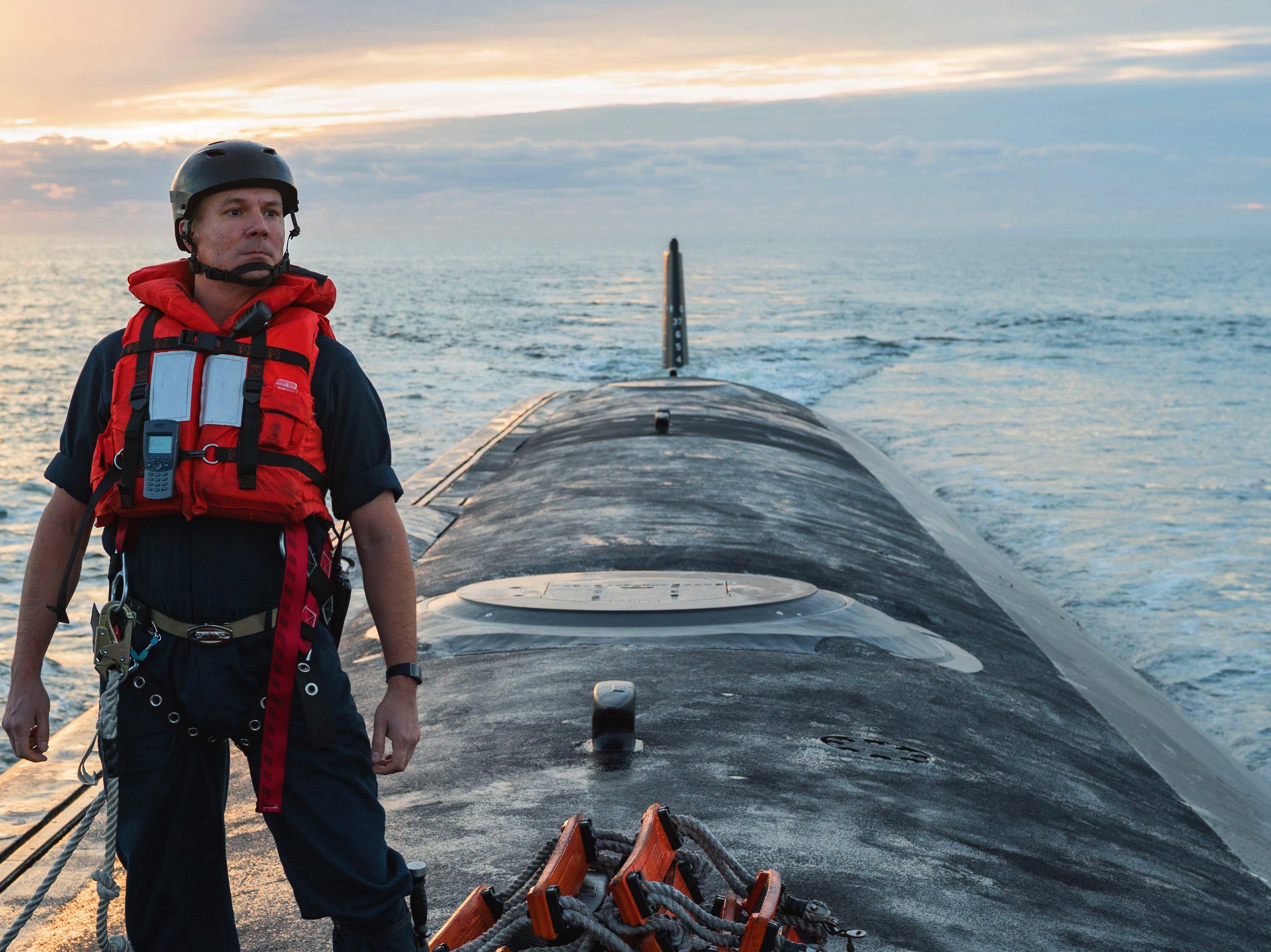A U.S. Navy Chief Petty Officer of the Boat, a pre-commissioned Unit (PCU) South Dakota submariner, stands and watches as the submarine arrives into Port Canaveral during an underway somewhere in the Atlantic Ocean Nov. 27.