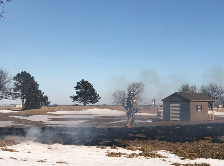 A patch of grass burned near the golf cart shed at Elmwood Golf Course.