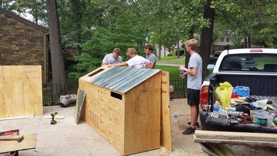 Joe Van Hoesen, a member of Boy Scout Troop 201, completed a recycling center project to benefit Harmony House as part of his quest to reach the rank of Eagle.