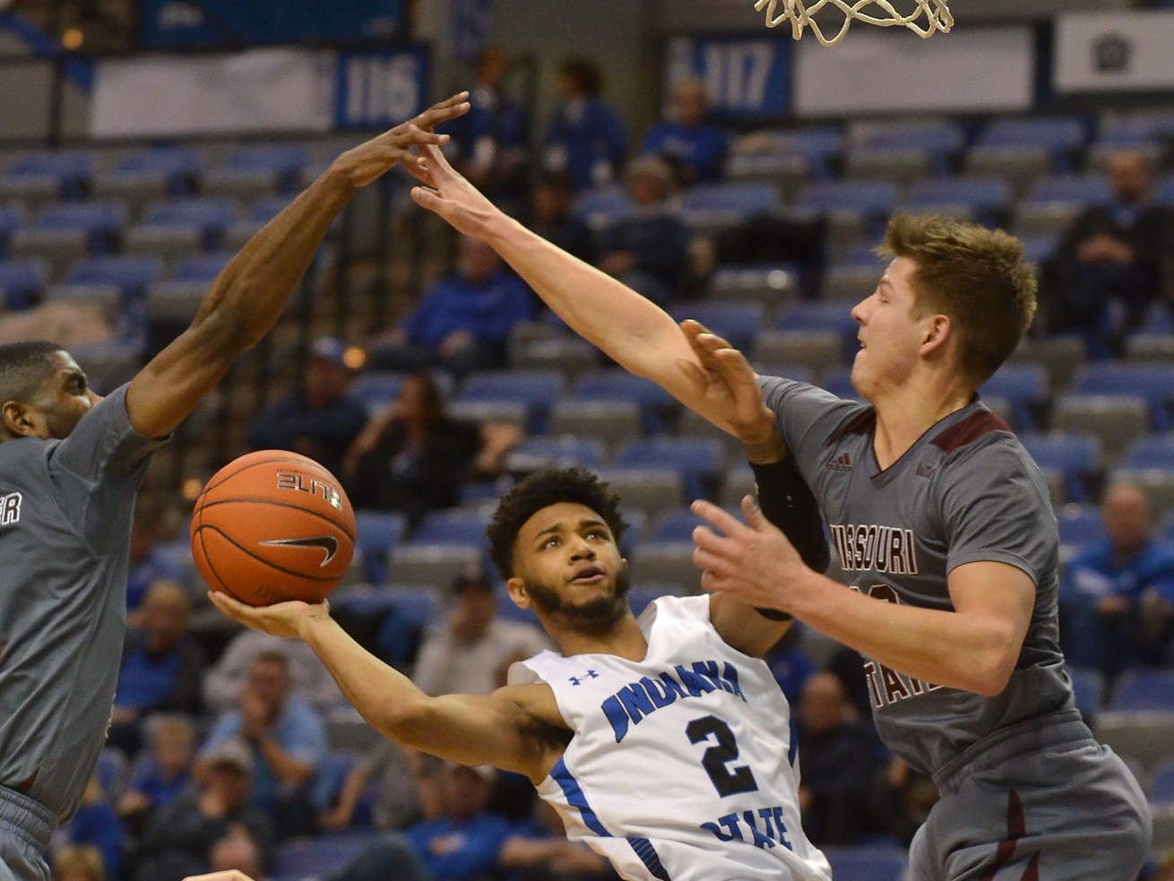 Indiana State's Jordan Barnes is blocked by Missouri State's Josh Webster and Ryan Kreklow during the Sycamores' 72-57 loss on Tuesday, Jan. 8, 2019 in Terre Haute, Ind. (AP Photo/Tribune-Star, Joseph C. Garza)