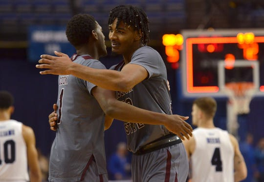 Missouri State's Keandre Cook hugs teammate Tulio Da Silva after the Bears defeated Indiana State 72-57 on Tuesday, Jan. 8, 2019 in Terre Haute, Ind.