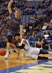 Indiana State's Jordan Barnes slips as he tries to drive around Missouri State's Jan Wojcik during the Sycamores' 72-57 loss on Tuesday in Terre Haute, Ind.