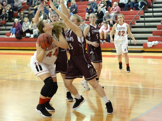Riverheads' Berkeley Tyree tries to put up a shot against the Stuarts Draft defense Tuesday night.