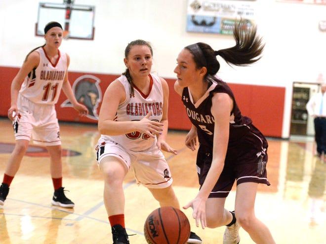 Stuarts Draft's Lyndsay Harris works to get around Riverheads' Dayton Moore Tuesday during a Shenandoah District girls basketball game.