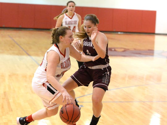 Stuarts Draft's Maggie Sorrells guards Riverheads' Dayton Moore Tuesday during a Shenandoah District girls basketball game.