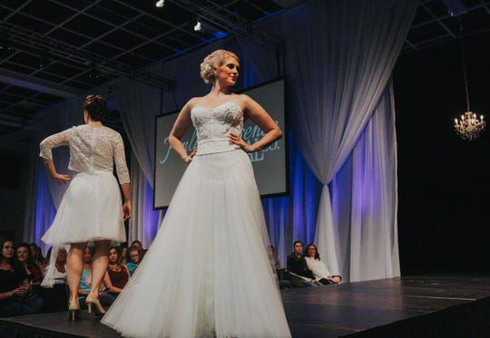 Models showcase the latest bridal fashions in this 2017 photo from the St. Cloud Wedding Expo.