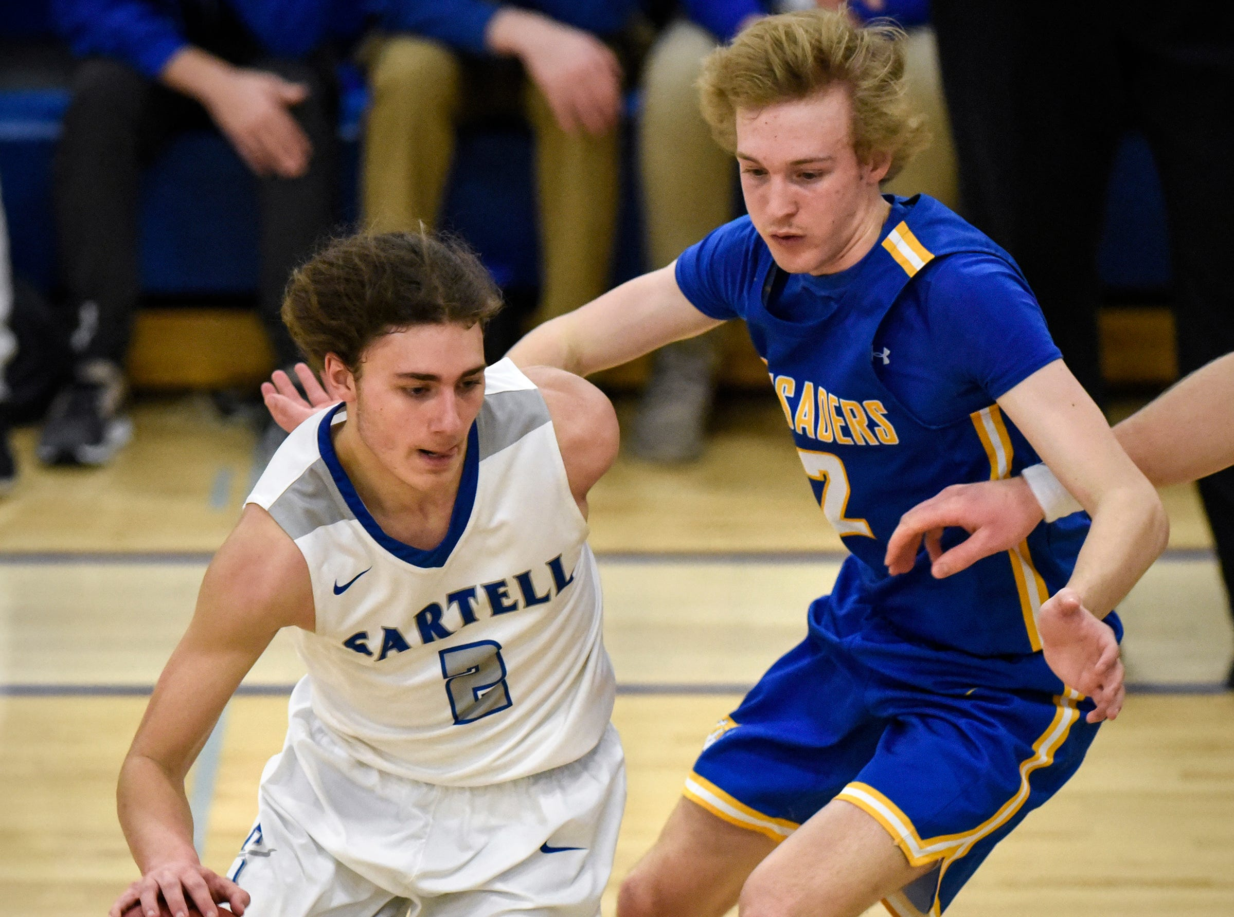 Sartell's Matt Sieben drives to the basket against Andrew Weisser of Cathedral during the game Tuesday, Jan. 8, at Cathedral High School in St. Cloud. Sartell won 75-71. Visit www.sctimes.com/sports to see more photos from the game.