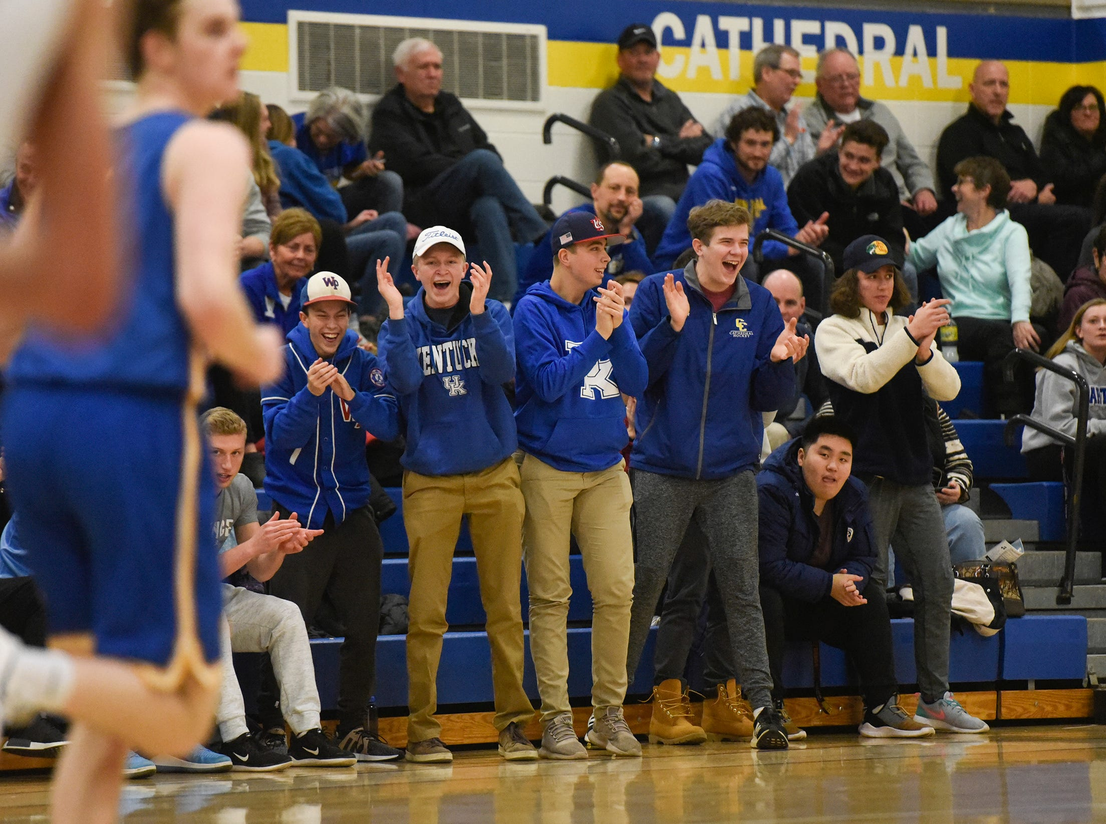 Fans cheer for their team during the game Tuesday, Jan. 8, at Cathedral High School in St. Cloud.