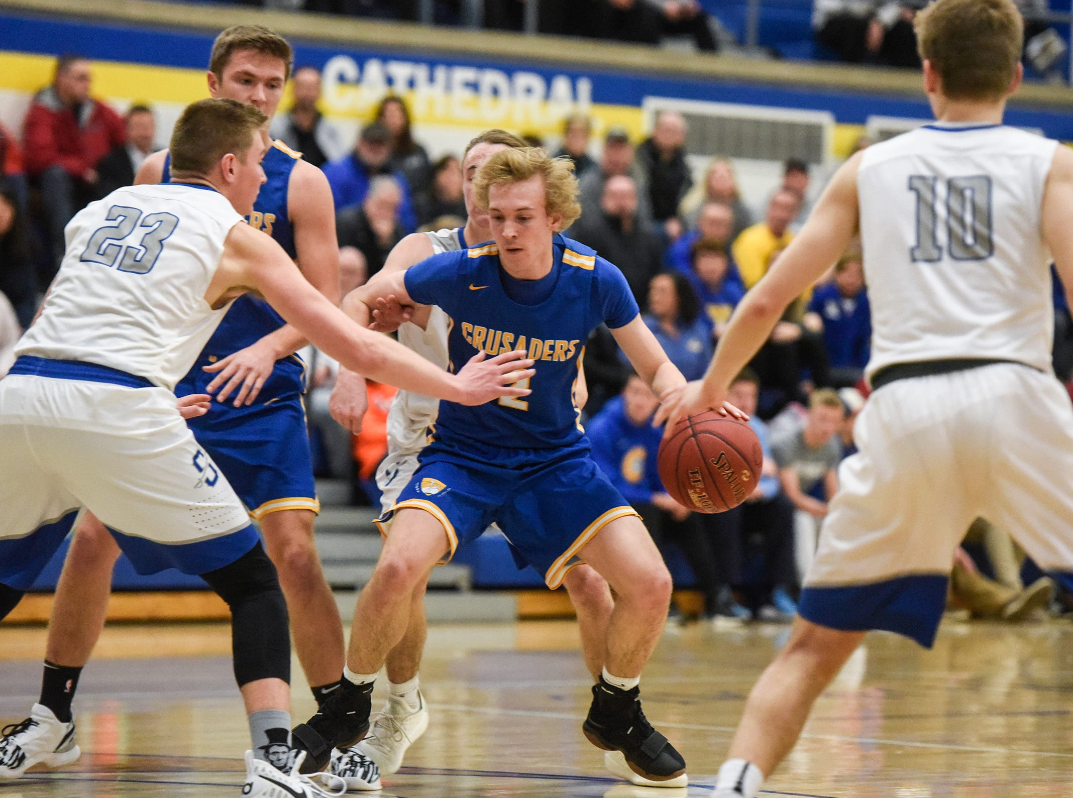 Cathedral's Andrew Weisser drives to the basket during the game Tuesday, Jan. 8, against Sartell at Cathedral High School in St. Cloud.