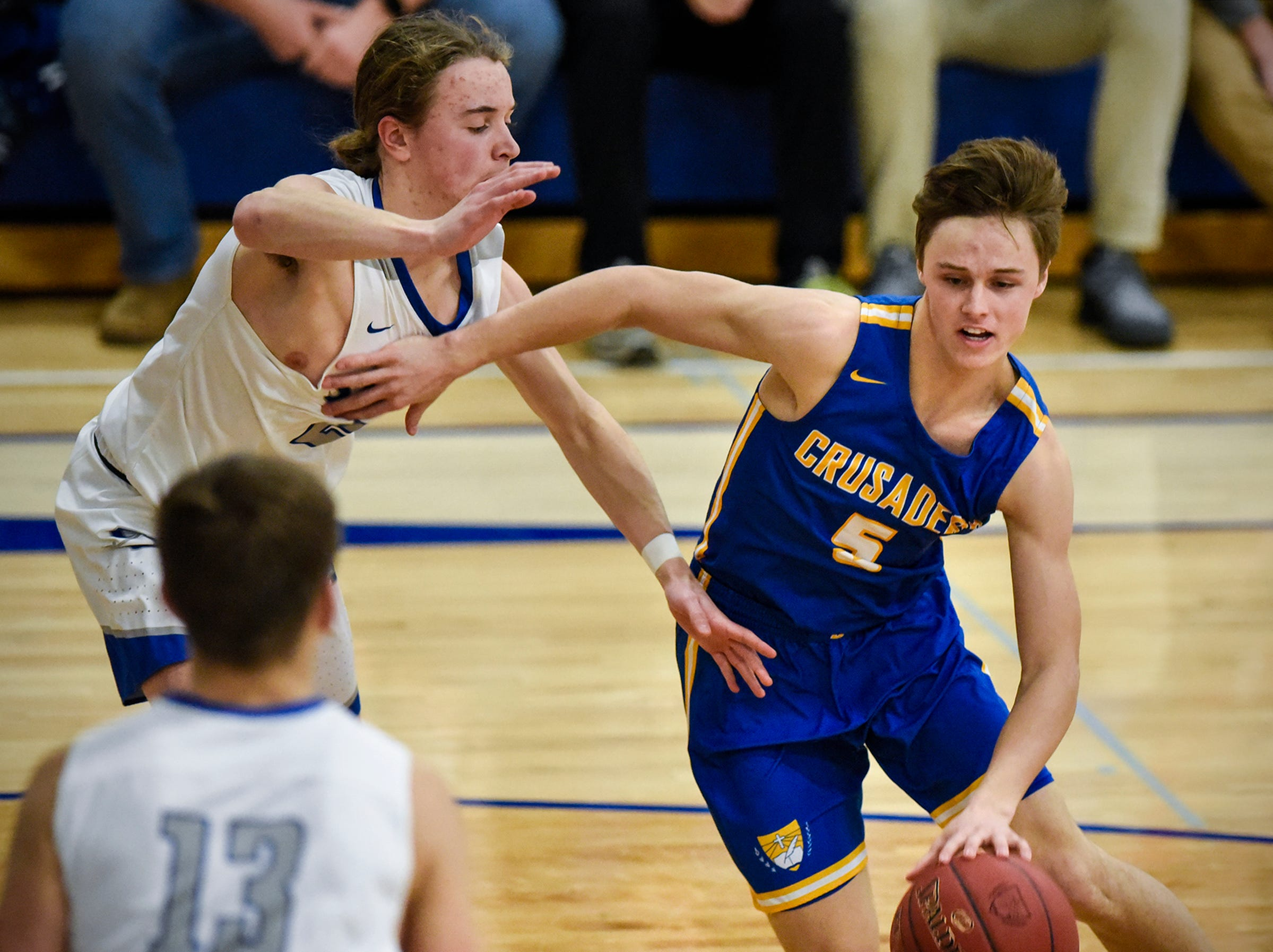 Cathedral's Jackson Jangula drives to the basket during the game Tuesday, Jan. 8, against Sartell at Cathedral High School in St. Cloud.