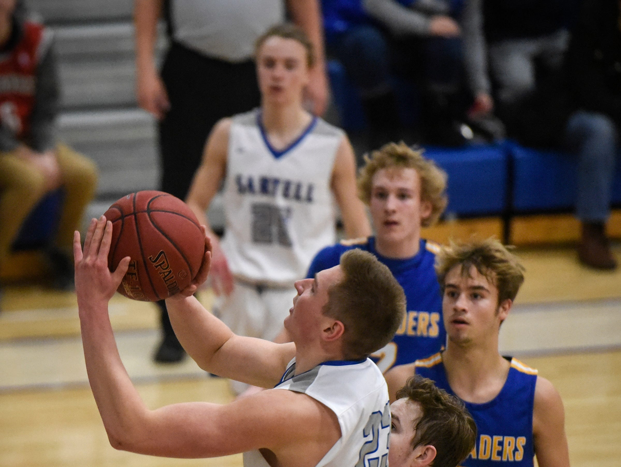 Sartell's Thomas Gieske puts up a shot during the game Tuesday, Jan. 8, at Cathedral High School in St. Cloud.