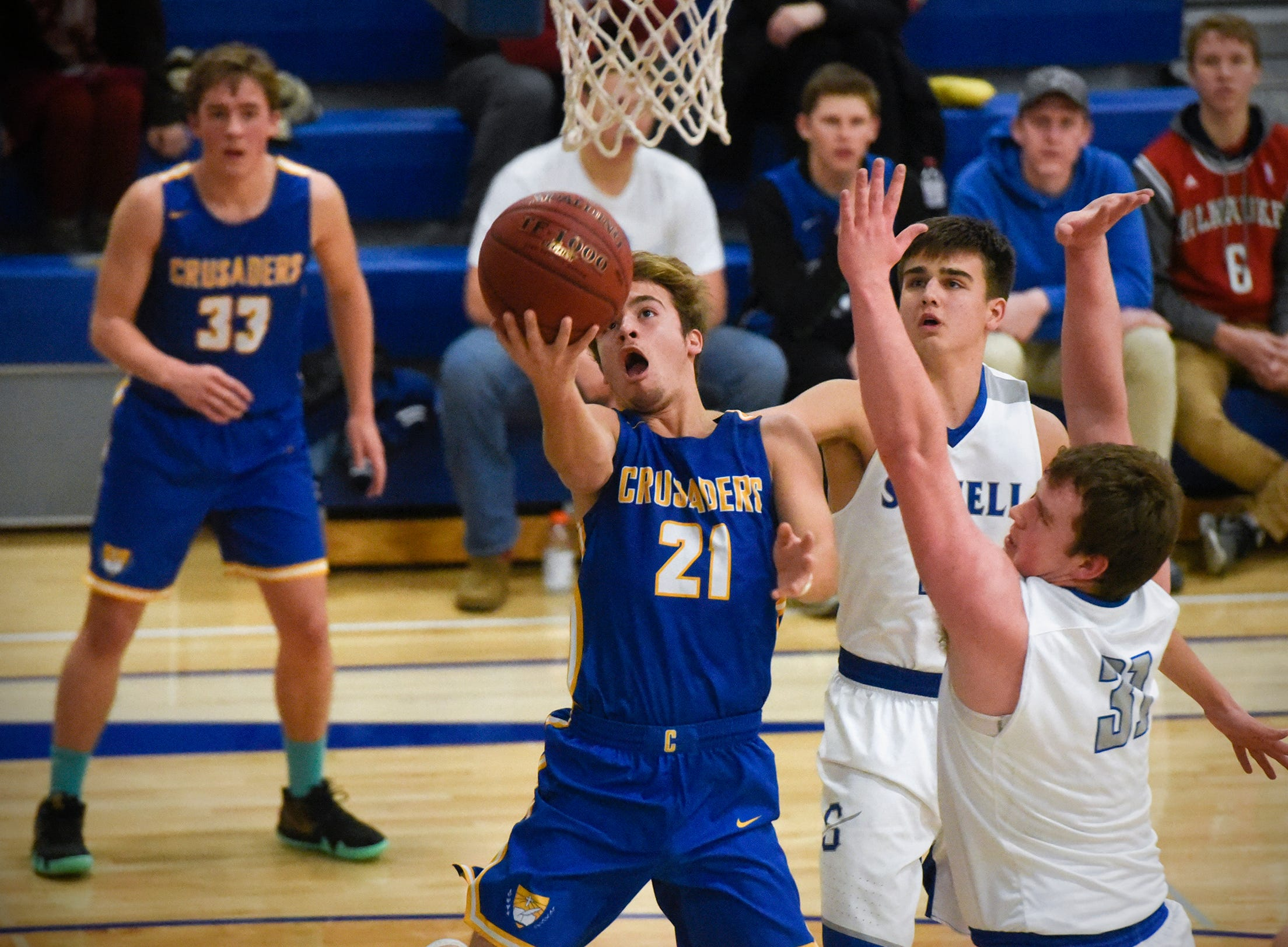 Sam Schneider puts up a shot for Cathedral during the game Tuesday, Jan. 8, against Sartell at Cathedral High School in St. Cloud.