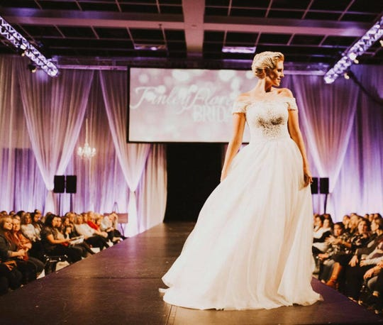 A model takes her turn down the runway at one of the St. Cloud Wedding Expo's bridal fashion shows in Jan. 2018.