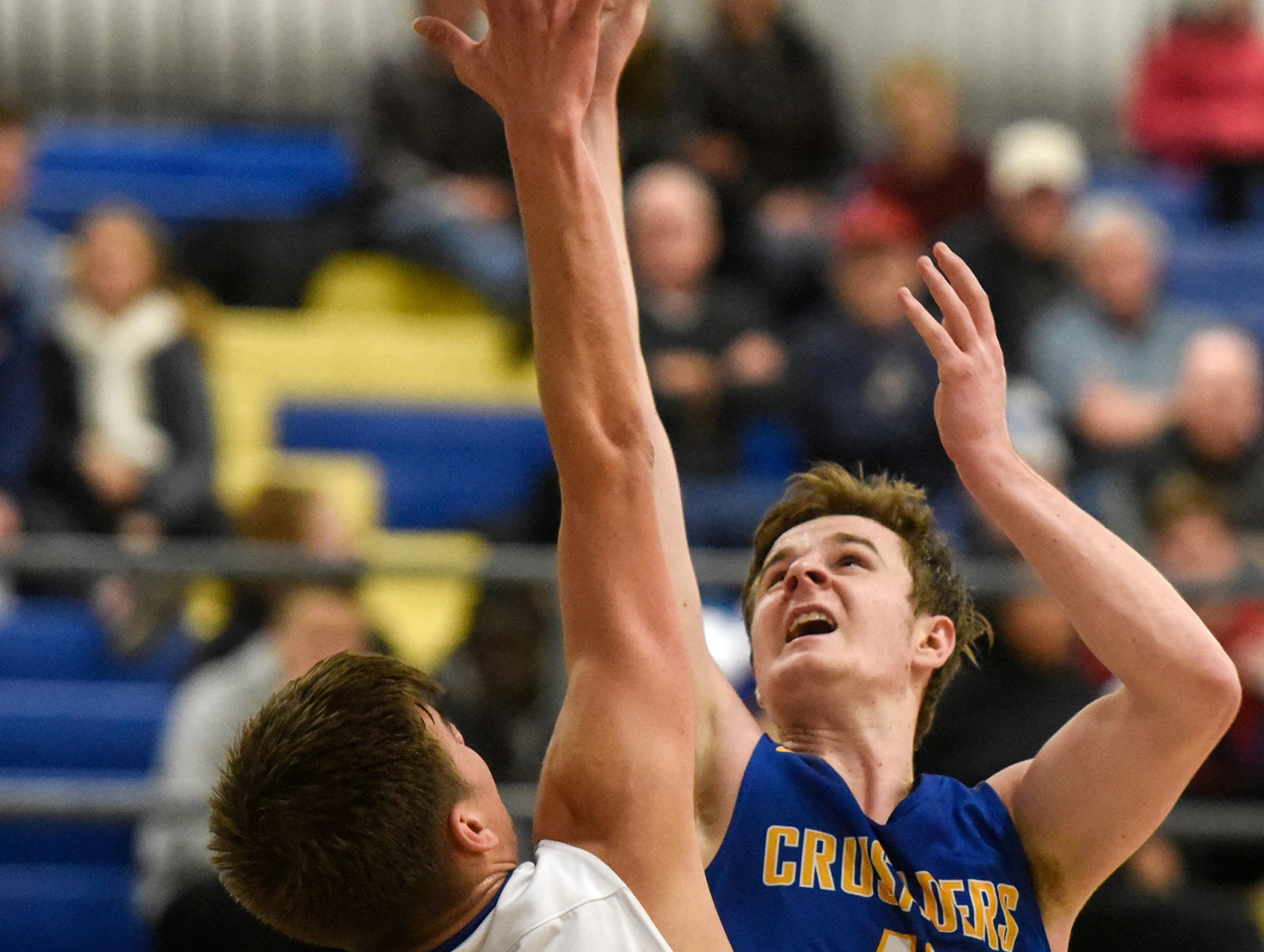 Cathedral's Nick Schaefer tries to get a shot over Luke Tillotson of Sartell during the game Tuesday, Jan. 8, at Cathedral High School in St. Cloud.
