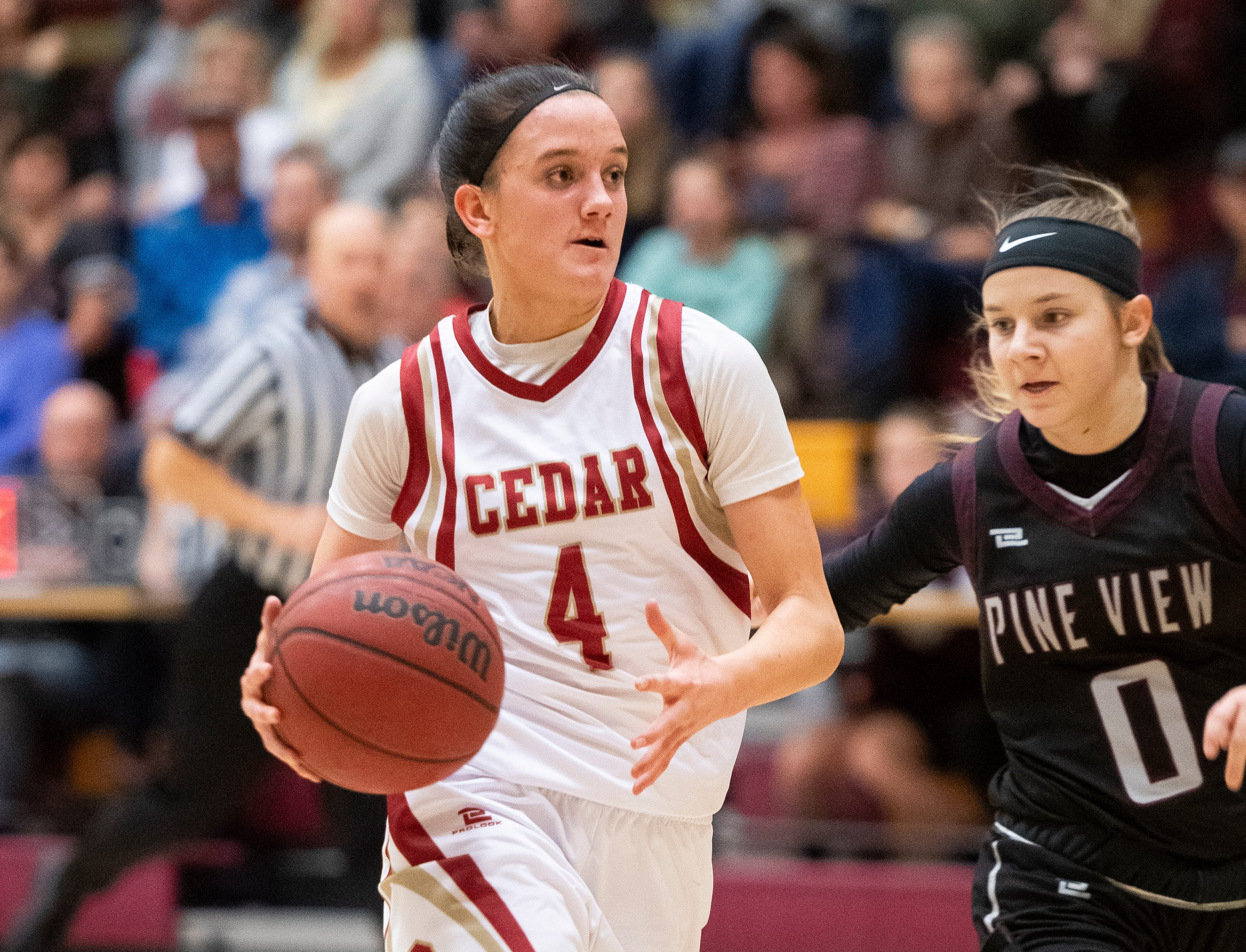 Cedar High School sophomore Logann Laws (4) moves the ball against Pine View at CHS Tuesday, January 8, 2019. Cedar remains undefeated with a 63-40 win over the Panthers.